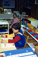 Will (6 1/2) and Christina (1 1/2) in our Montessori homeschool classroom. (Photo by Deb Chitwood)