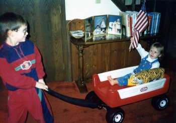 Will (6 1/2) and Christina (1 1/2) during an in-house parade in 1992.