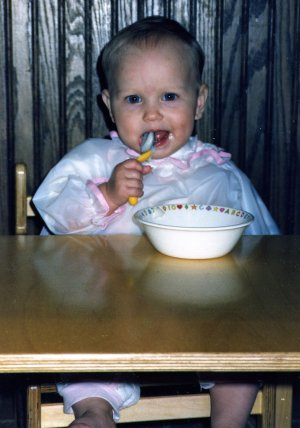 Christina (8 mos.) eating her homemade organic baby food in 1990.