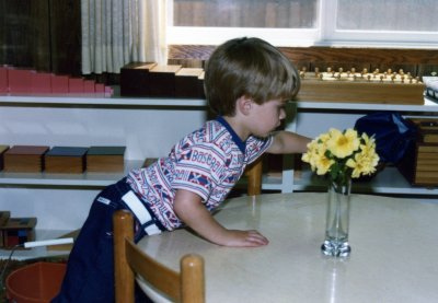 A child cleaning at the end of the individual work time in my Montessori school in 1981.
