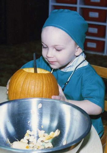 Will (2 1/2) performing pumpkin surgery, 1987.