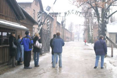 "Will, 20, and Christina, 15, with a skating tour group hearing about the infamous sign over the gate at Auschwitz that reads ""work sets you free,"" November 2005."