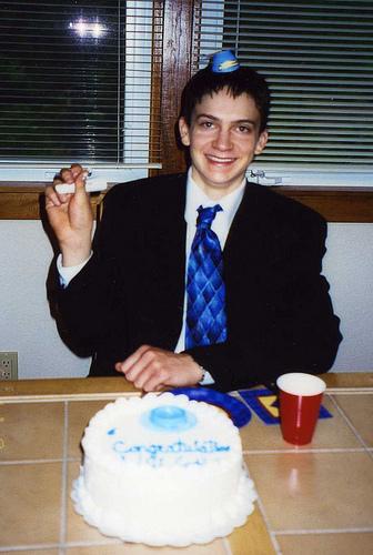 Will having fun at his graduation party.