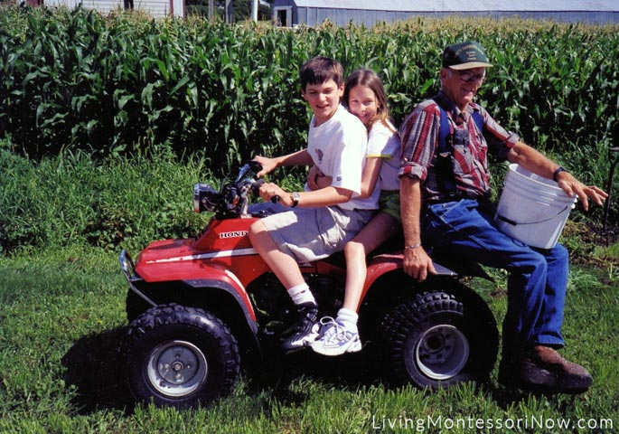 Will (15), Christina (10), and Grandpa Glenn on the way to pick potatoes from Grandma and Grandpa's garden, 2000