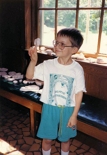 Will (6) showing his clay work at the Creative Earthworks Family Day, 1991.
