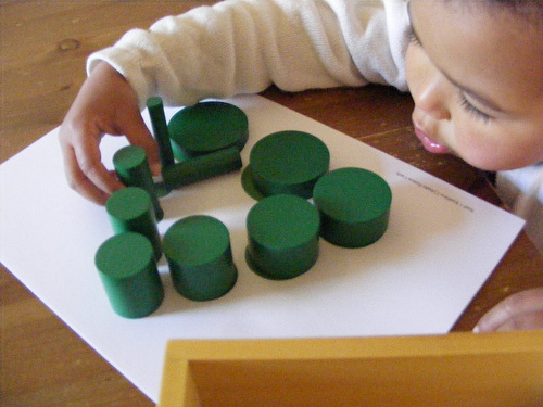 Working with Montessori Knobless Cylinders (Photo from Homeschool Escapade)