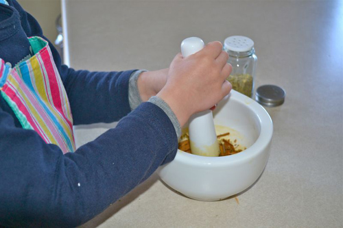 Using a Mortar and Pestle after Demonstration (Photo from How We Montessori)