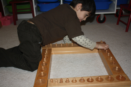 Working with Four Cylinder Blocks at Once with Their Built-in Control of Error (Photo from Montessori MOMents)