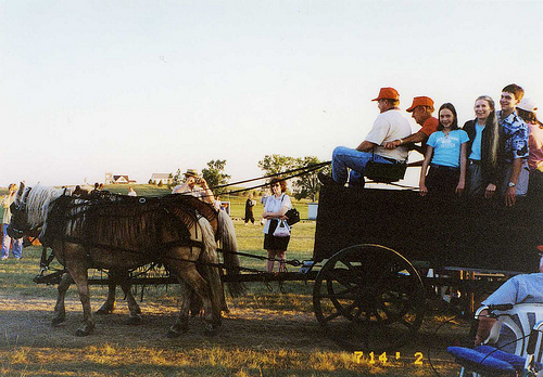 Christina, 12, Deb, and Will, 17, on a wagon ride at the Laura Ingalls Wilder Pageant, July 2002.