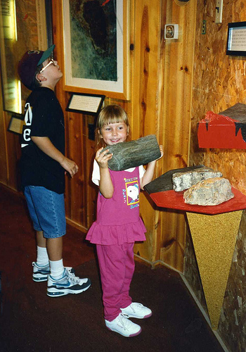 A study of geology included a visit to the Petrified Forest of the Black Hills. Will (9) and Christina (4), 1994.