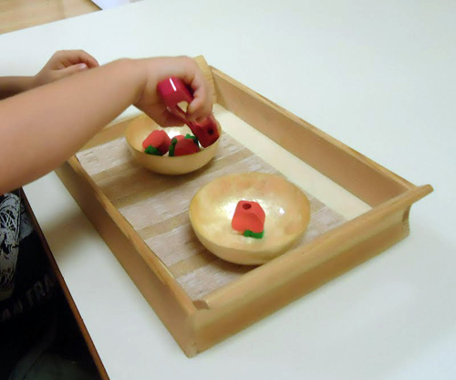 Tonging Apple Beads (Photo from Dirigo Montessori School)