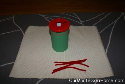 Practicing In and Out with Chenille Sticks (Photo from Our Montessori Home)