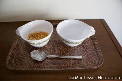 Spooning Corn Kernels (Photo from Our Montessori Home)