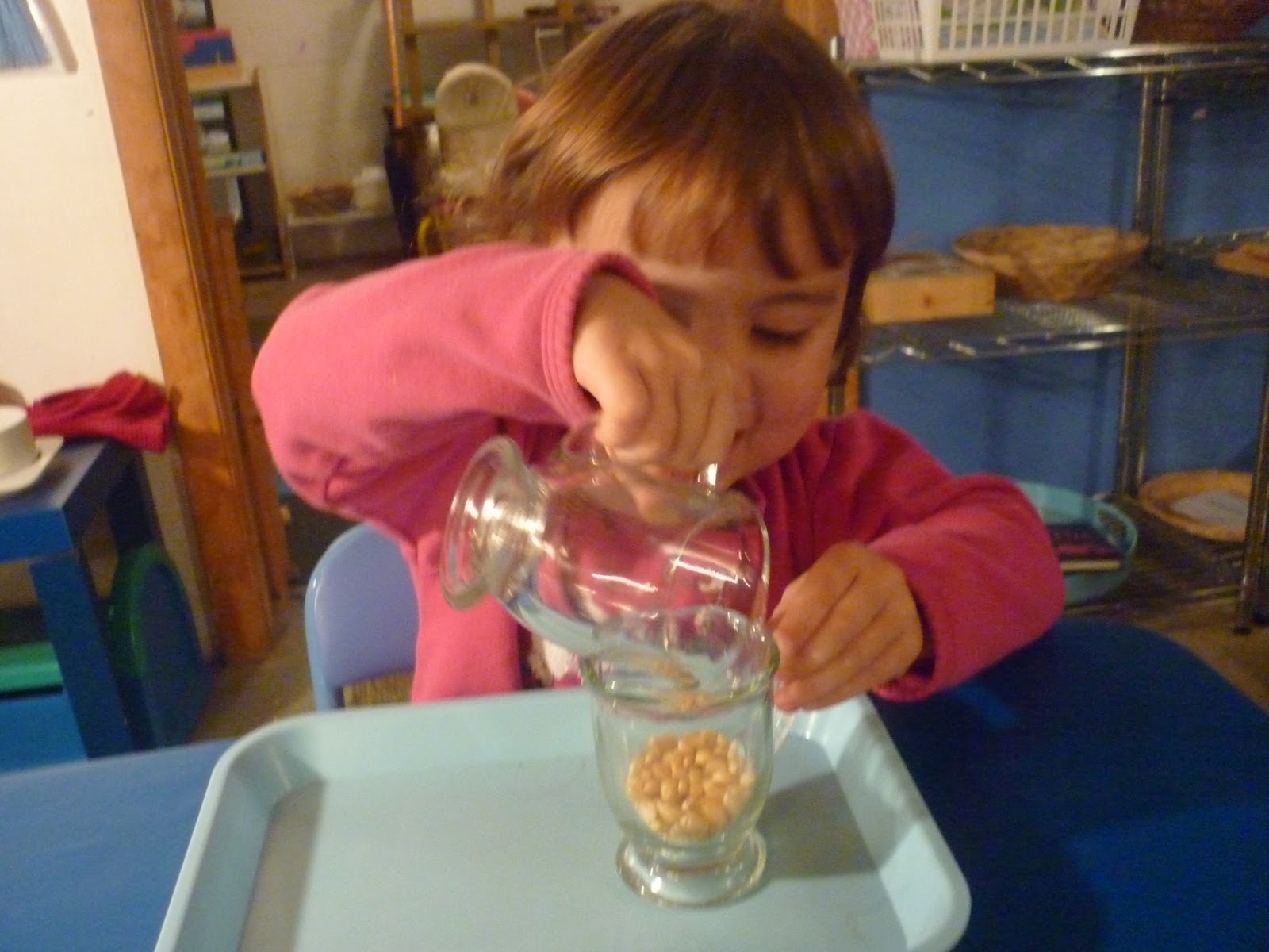 Pouring corn kernels (Photo from The Work Plan)