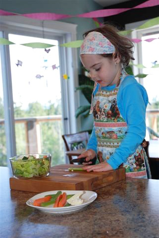 Montessori Food Preparation - Making a Salad with Food She Picked from the Garden (Photo from The Montessori Child at Home)