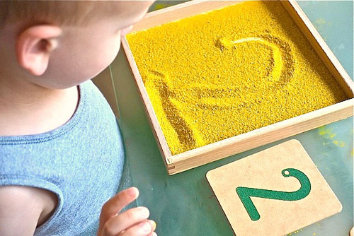 Sandpaper Numerals with a Sand Tray from How We Montessori