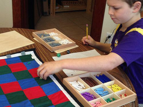 Elementary Math Work with Montessori Checkerboard (Photo from Work and Play, Day by Day
