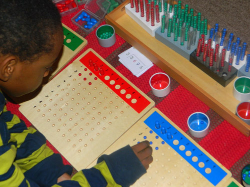 Montessori Long Division Boards with Racks and Tubes (Photo from We Don't Need No Education)