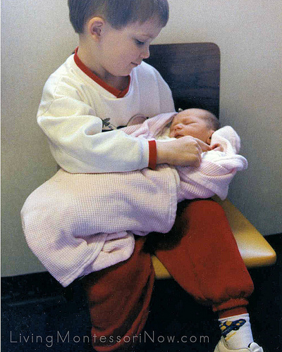 Christina (one day old) with Will (5), 1990.