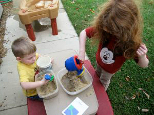 DIY Land and Water Forms Using Sand and Water (Photo from OurMontessoriHome.Wordpress.com)