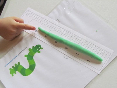 Measuring Play Dough Inchworms (Photo from Teach Preschool)