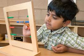 Student Working with the Small Bead Frame (Photo from Montessori Compass)