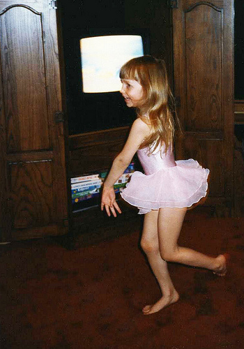 Christina at age 4 dancing to a video playing on our video monitor.