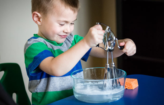 Making Soap Suds with an Egg Beater (Photo from KHT Montessori)