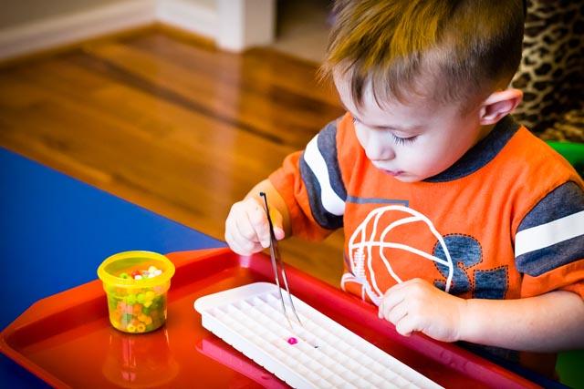 Using Tweezers (Photo from KHT Montessori)