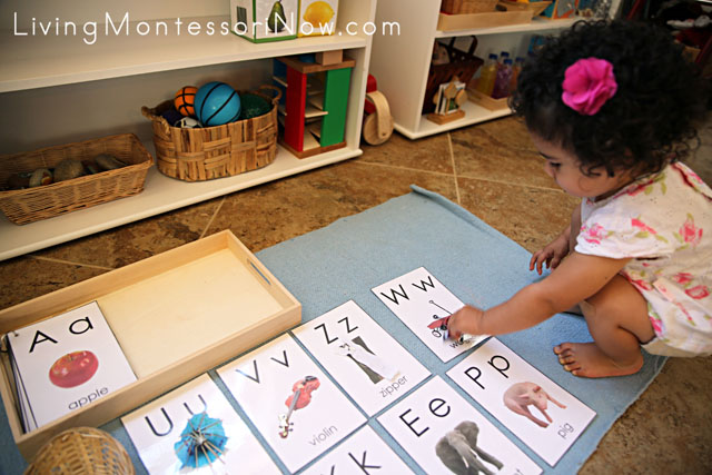 Having fun with alphabet cards and miniature objects at 21 months