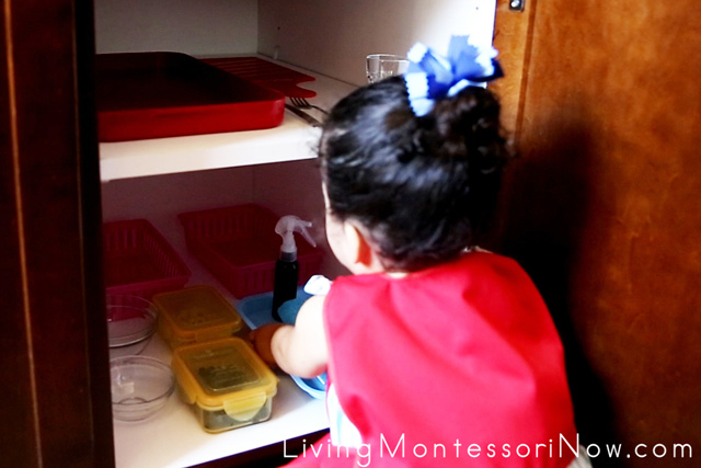 Removing the Table Washing Tray from the Snack Cupboard at 21 Months