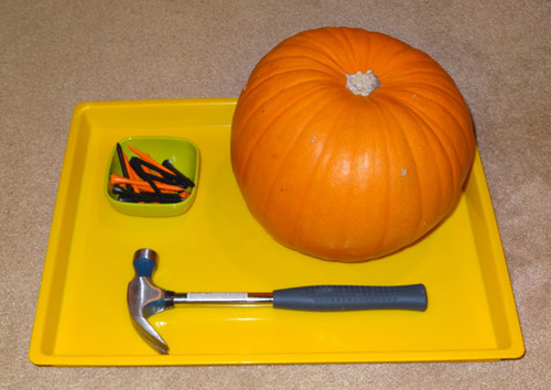Hammering Golf Tees in a Pumpkin (Photo from Gift of Curiosity)