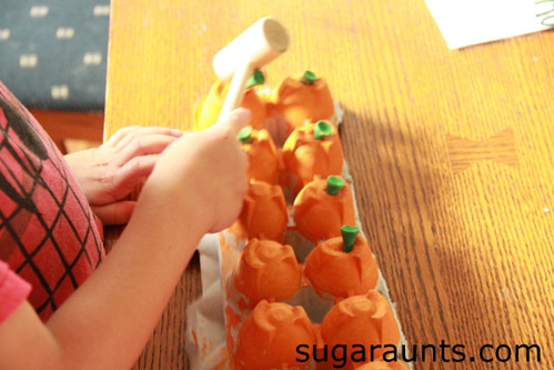 Hamming Golf Tees into Egg-Carton Pumpkins (Photo from Sugar Aunts)