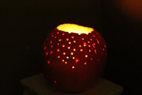Lit Pumpkin with Holes from Golf Tee Hammering (Photo from I Can Teach My Child)