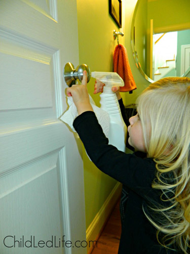 Cleaning the Bathroom Door (Photo from Child Led Life)