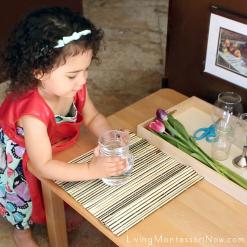 Bringing a Water Jug for Montessori Flower Arranging