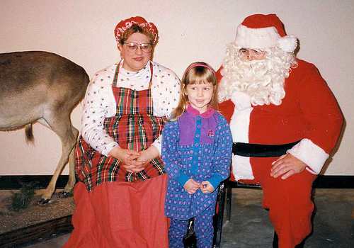 Christina (3½) with Santa and Mrs. Claus at the zoo museum, 1993