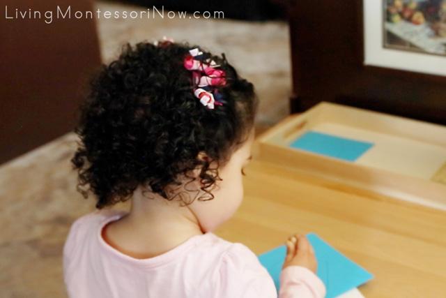 Pin Poking a Montessori Inset Pentagon Shape