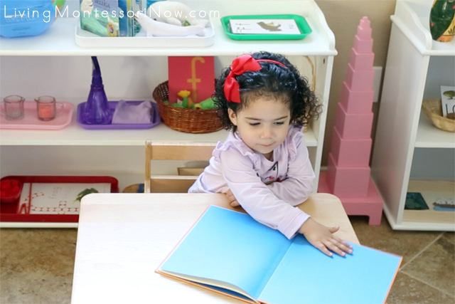 Demonstrating How to Open a Book at Age 2