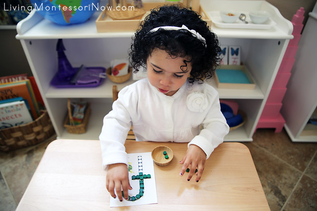 Putting Wooden Dots on Frog Do-a-Dot Printable