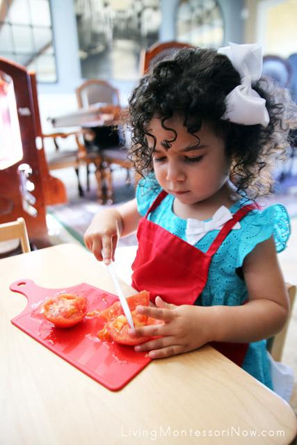 Cutting a Tomato for Gluten-Free Whole-Grain Avocado Sandwiches
