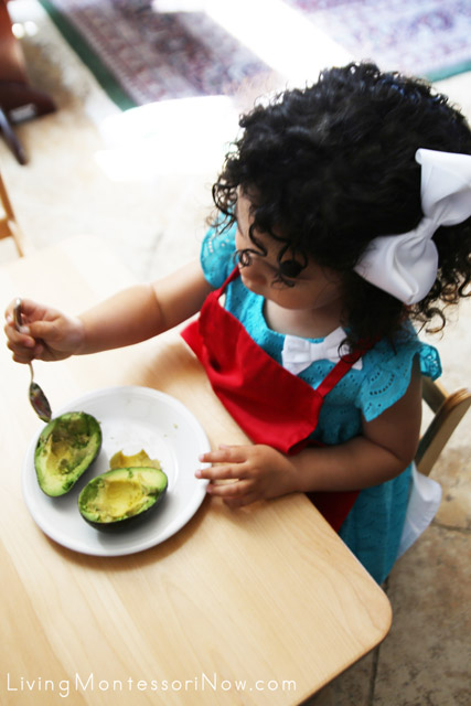 Scooping out an Avocado for Gluten-Free Whole Grain Avocado Sandwiches