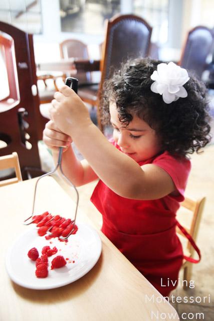 Mashing Raspberries for Popsicles