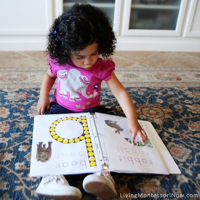 Reading Her Animal Alphabet Book