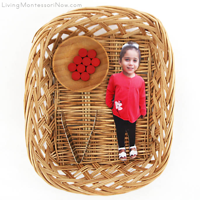 Basket with Child's Photograph and Spielgaben Wooden Dots for Ten Apples Up On Top Activity