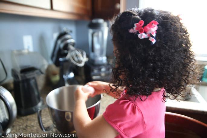 Cracking an Egg for Gluten-Free Pumpkin Muffins