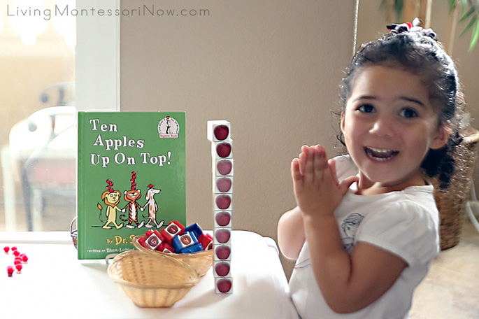 Excited about Her Work with Stacking Ten Apples Up On Top