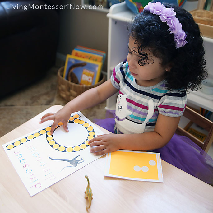 """Counting the Sticker Dots Placed on Her """"d is for dinosaur"""" Do-a-Dot Page"""