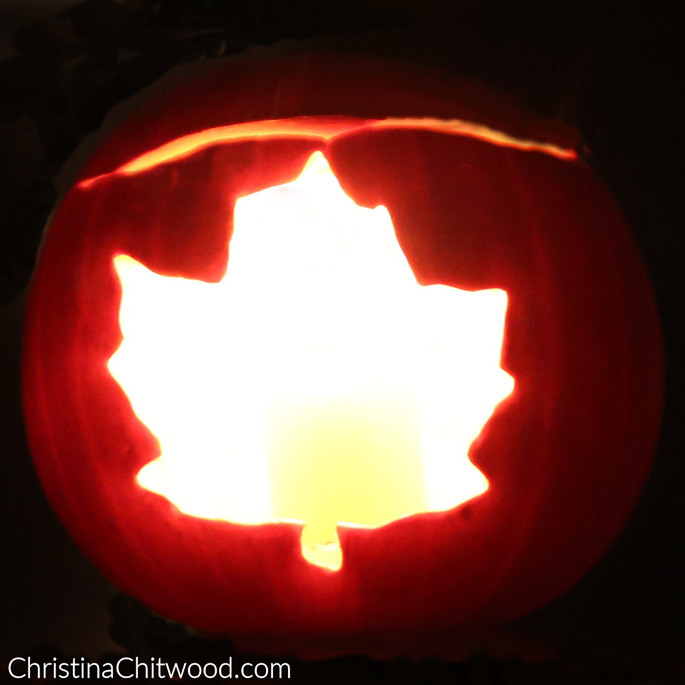 Carved Pumpkin with a Fall Theme