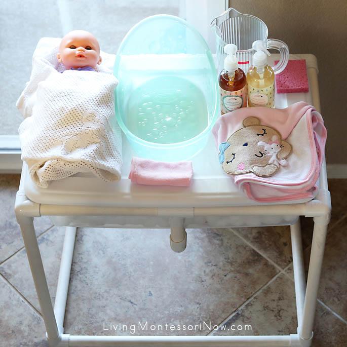 Baby Doll Washing Setup on Lid of Sensory Table